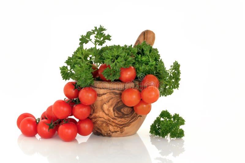 Tomaten en het Kruid van de Peterselie stock foto's