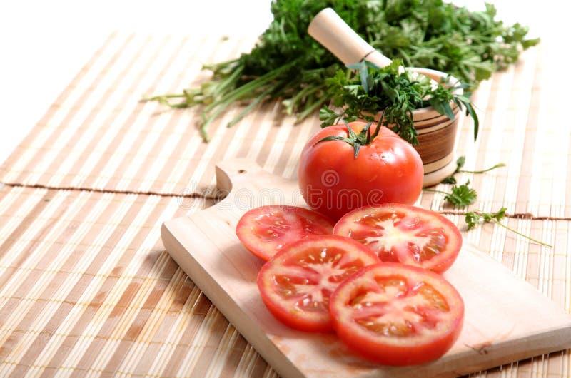 Tomaten en koriander stock foto's