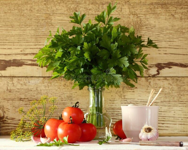 Tomaten en peterselie stock foto's