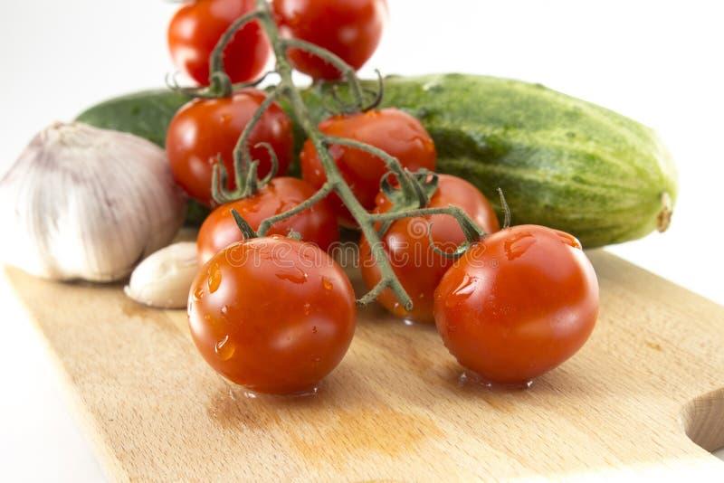 Tomaten, Gurke, Knoblauch lizenzfreie stockfotografie