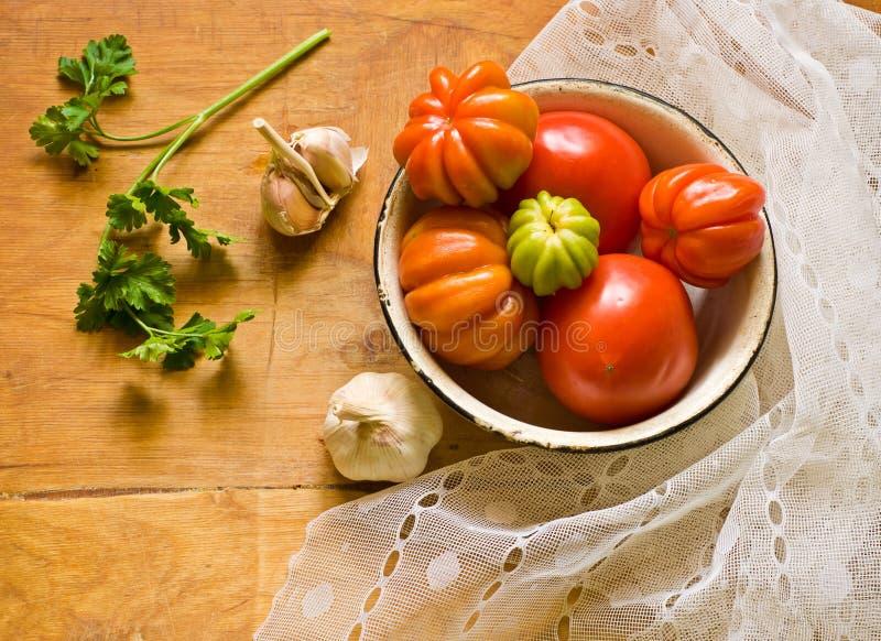Tomaten, knoflook en peterselie royalty-vrije stock fotografie