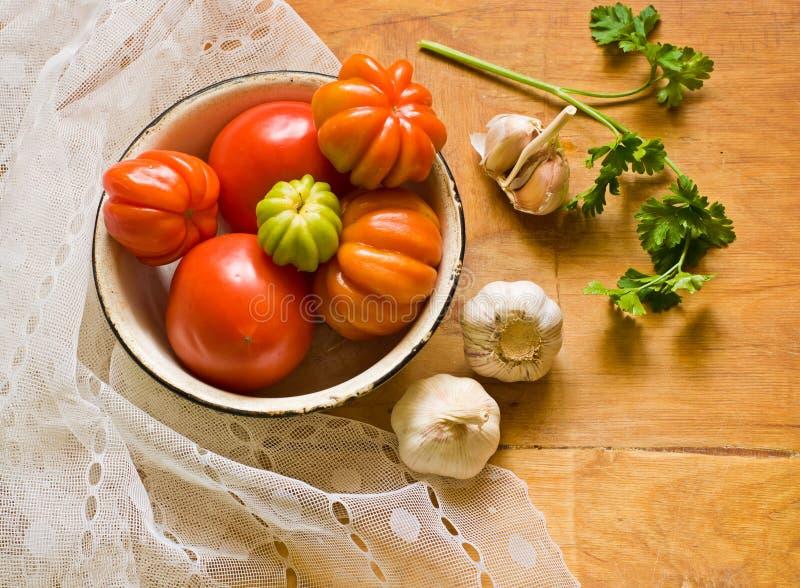 Tomaten, knoflook en peterselie stock afbeeldingen