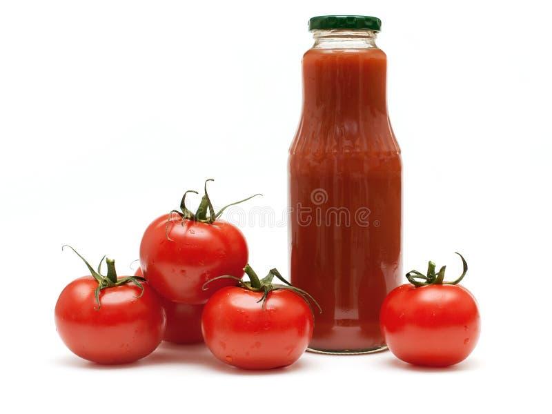 Tomaten und Tomatesaft lizenzfreies stockbild