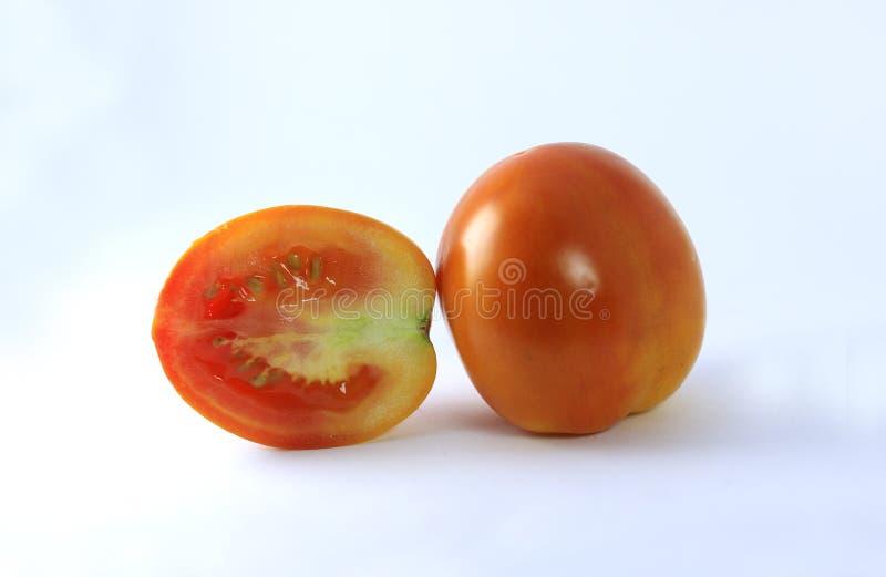 Tomatenhülsen über weißem Hintergrund lizenzfreie stockbilder