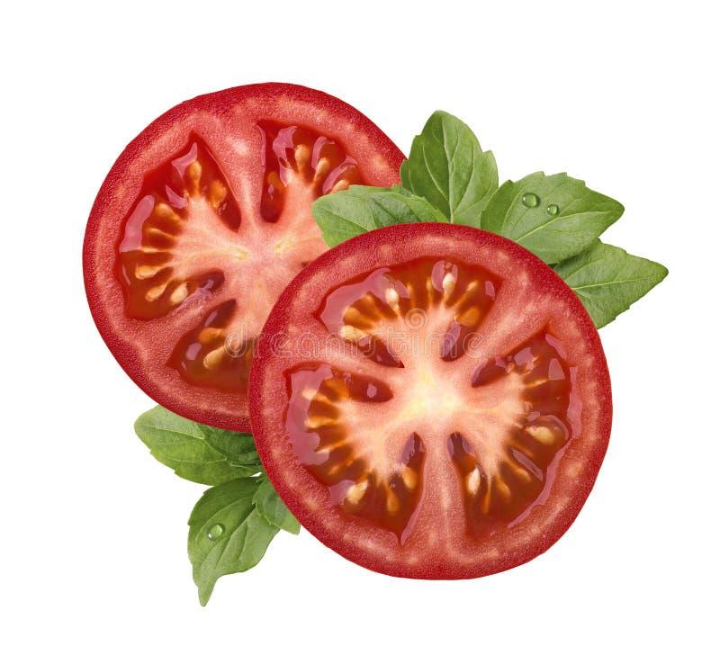 Tomatenscheibe und -basilikum lokalisiert auf weißem Hintergrund lizenzfreie stockfotografie