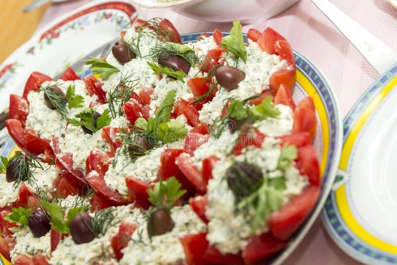 Tomater med ost royaltyfria bilder
