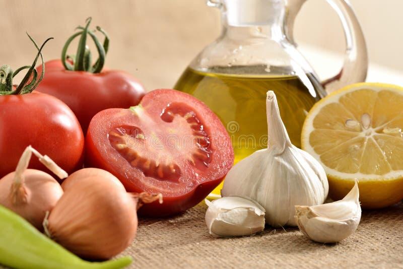 Tomates cebolla, ajo, pimienta, tomates imágenes de archivo libres de regalías