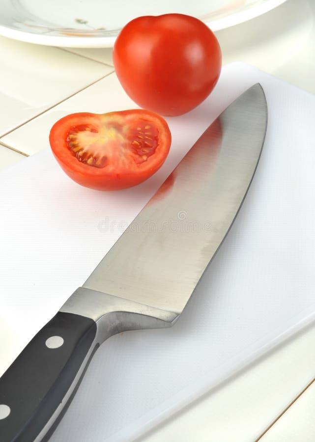 Tomates com faca foto de stock royalty free