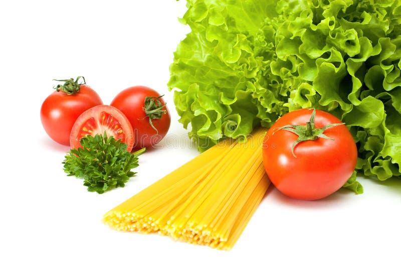 Tomates com salada e massa imagens de stock