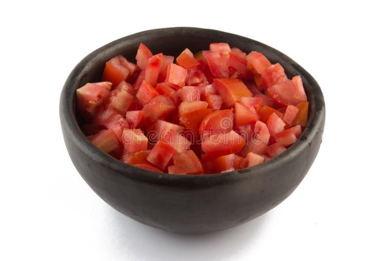 Tomates découpées dans une cuvette photo stock