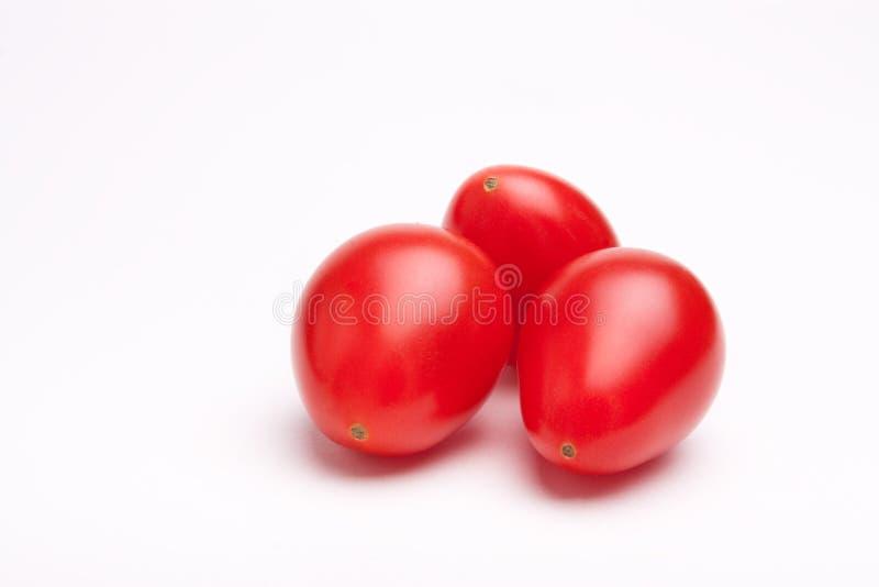 Tomates de ameixa da cereja foto de stock