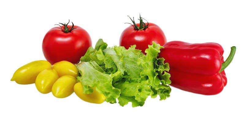 Tomates de la lechuga, de las pimientas, amarillos y rojos en el fondo blanco imágenes de archivo libres de regalías