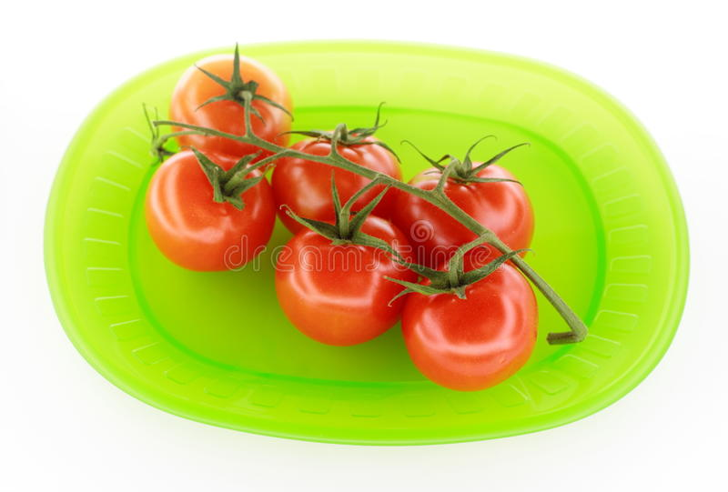 Tomates de plaque verte photo stock