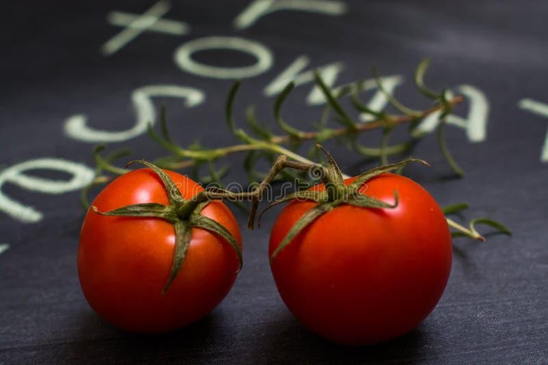 Tomates e alecrins de cereja fotos de stock royalty free