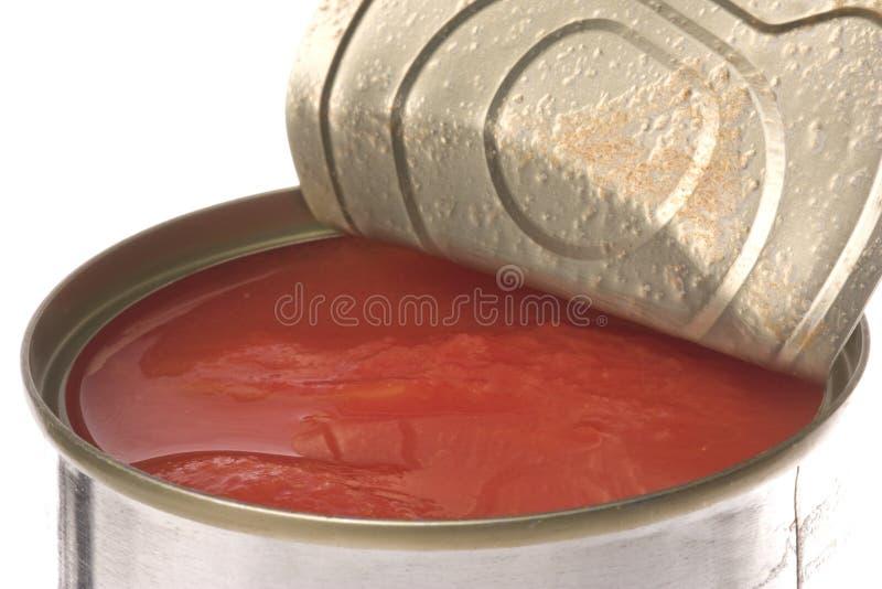 Tomates en boîte d'isolement photos stock