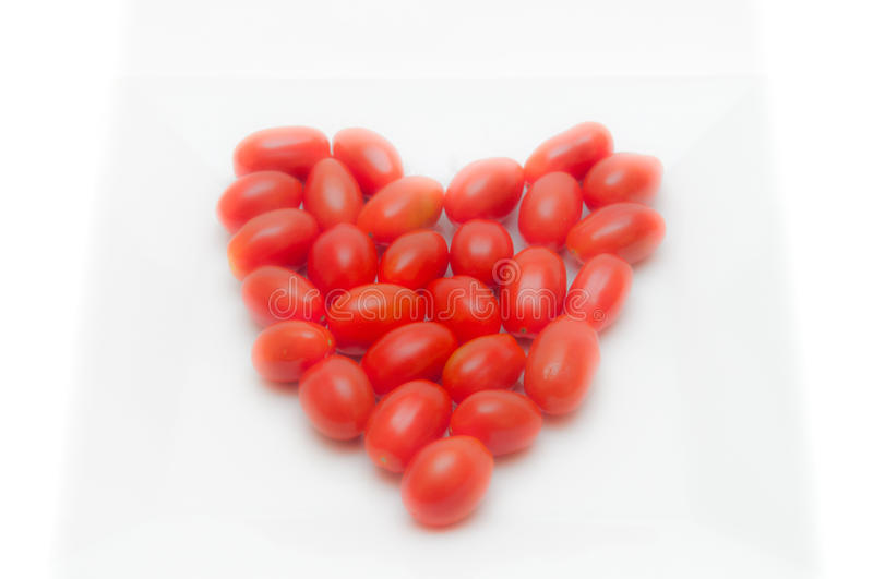 Tomates en forme de coeur rouges photos stock