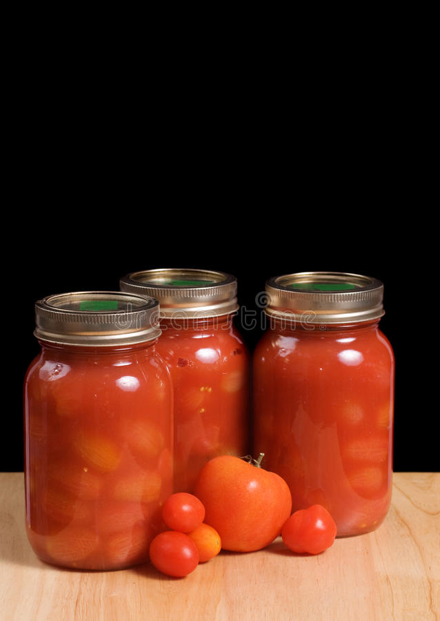 Tomates enlatados fotos de stock