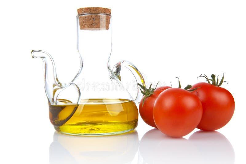 Tomates et burette images libres de droits