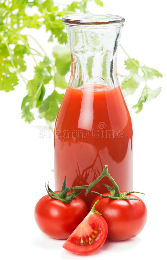 Tomates et jus photographie stock