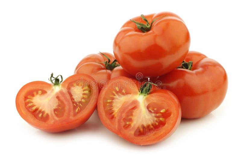 Tomates frescos da carne e um corte um foto de stock