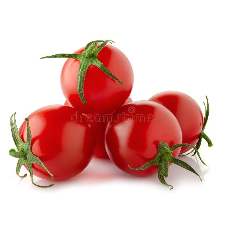 Tomates frescos isolados sobre fundo branco imagem de stock