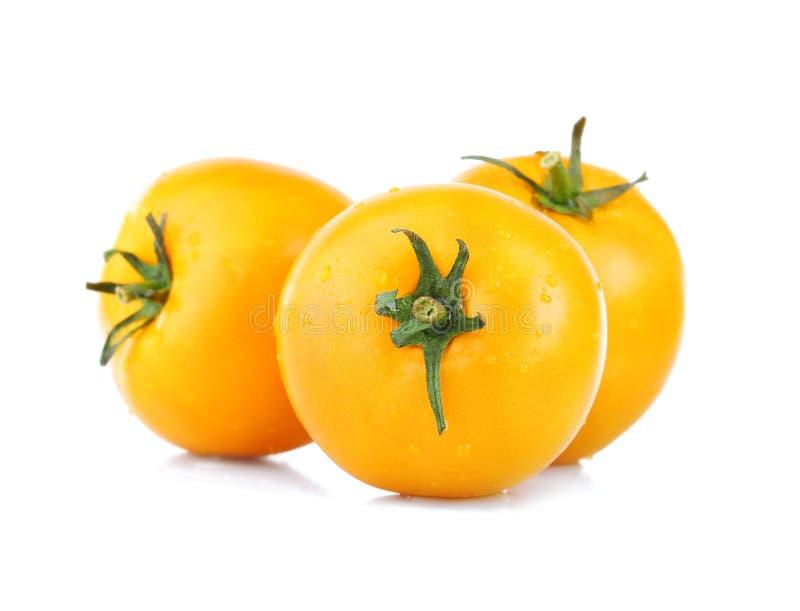 Tomates jaunes d'isolement sur le blanc photo stock