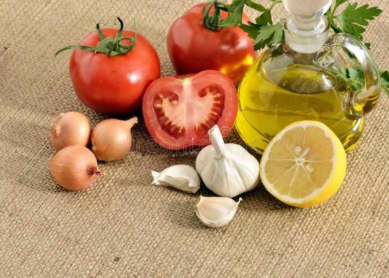 Tomates limón, ajo, tomates y fotos de archivo