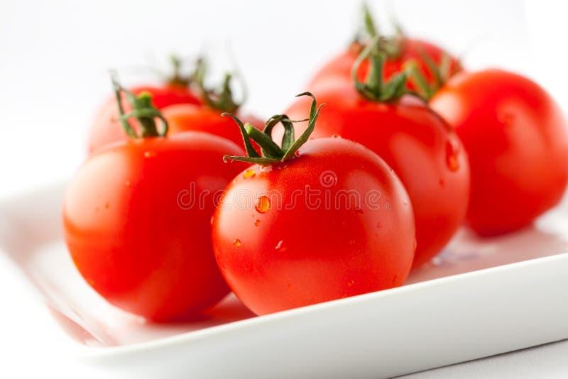 Tomates rojos frescos foto de archivo