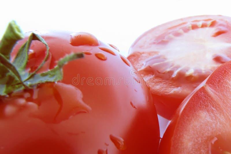 Tomates rouges coupées photos stock