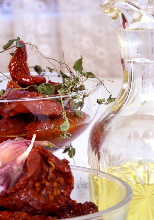 Tomates séchées au soleil de assaisonnement photographie stock