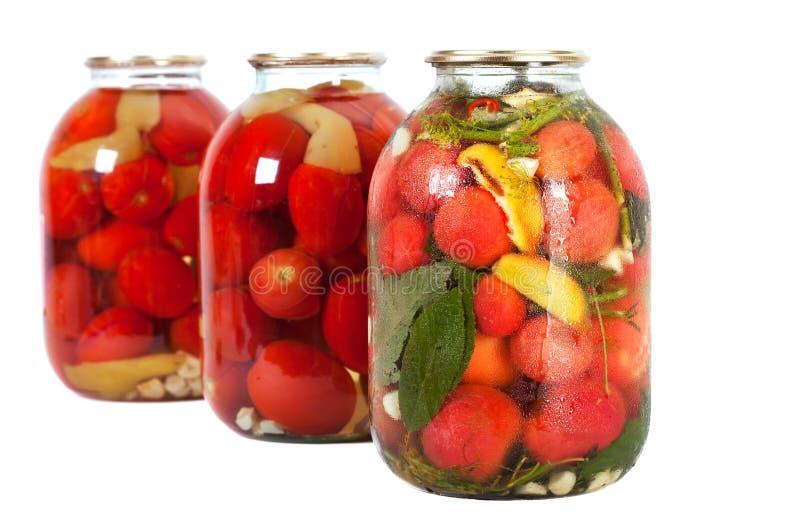 Tomates vermelhos em um frasco de vidro imagem de stock royalty free