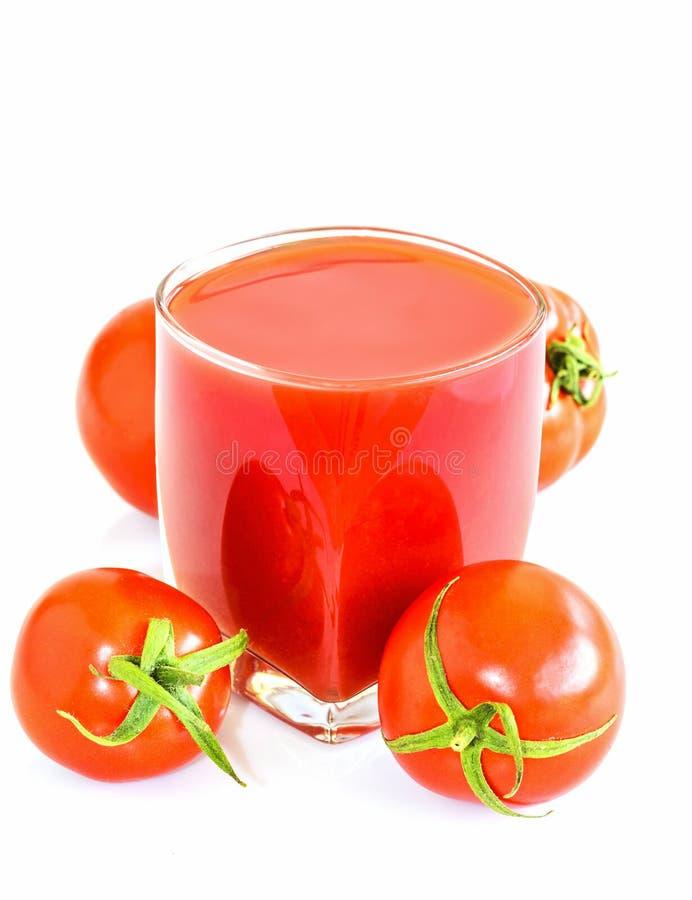Tomatfruktsaft för hälsa arkivbilder