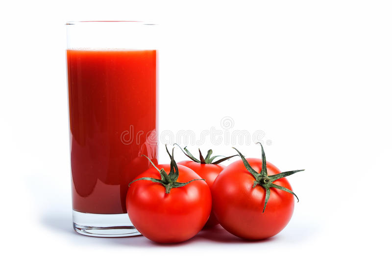 Tomatfruktsaft och tomater royaltyfri foto