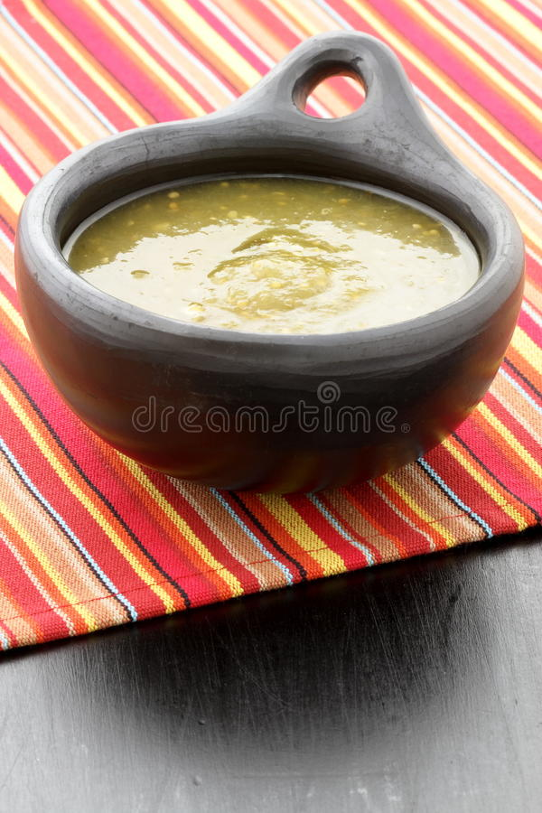 Tomatillo sauce in colombian clay dish stock image