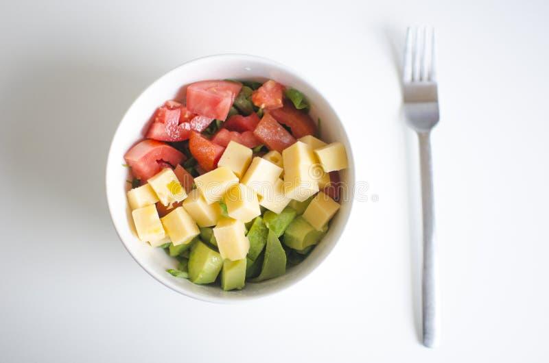 Tomato, avocado and cheese stock photo