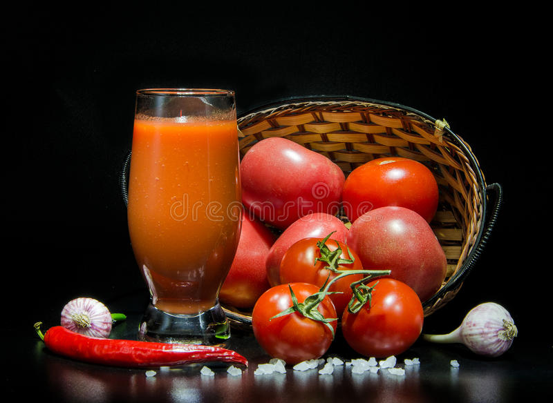 Tomato in basket royalty free stock images