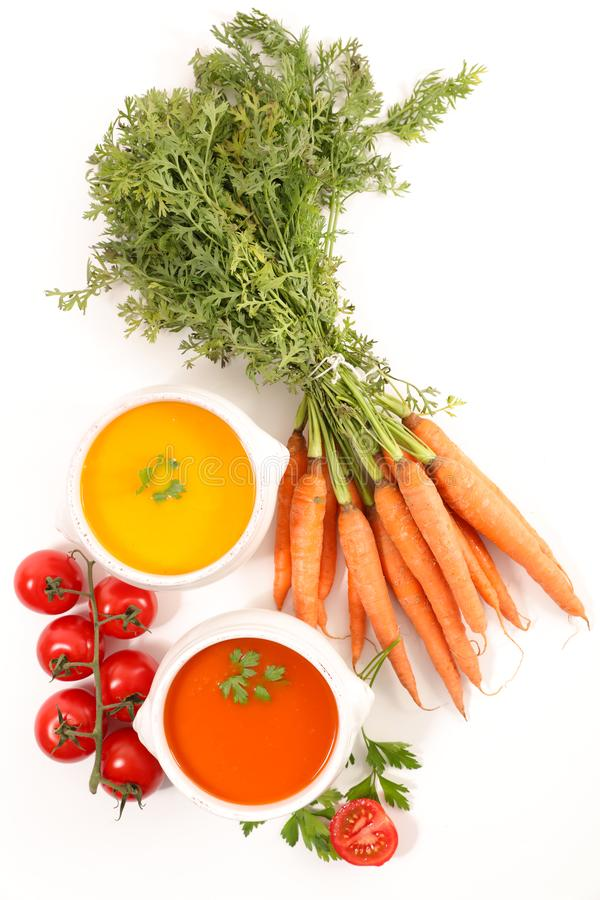 Tomato and carrot soup stock image