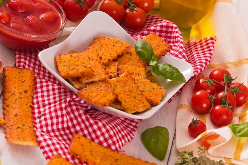 Tomato crackers. royalty free stock image
