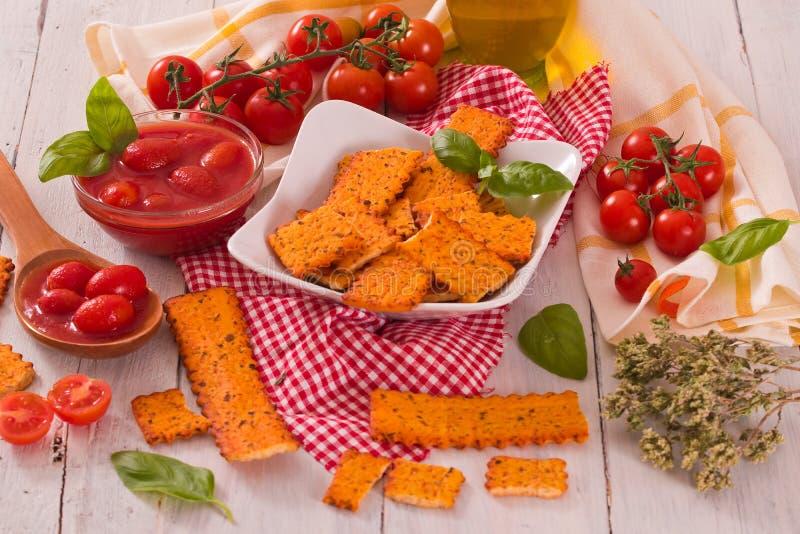 Tomato crackers. stock image
