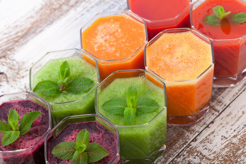 Tomato, cucumber, carrot, beet Juice and vegetables royalty free stock image