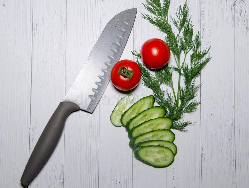 Fresh vegetables and knife stock photos