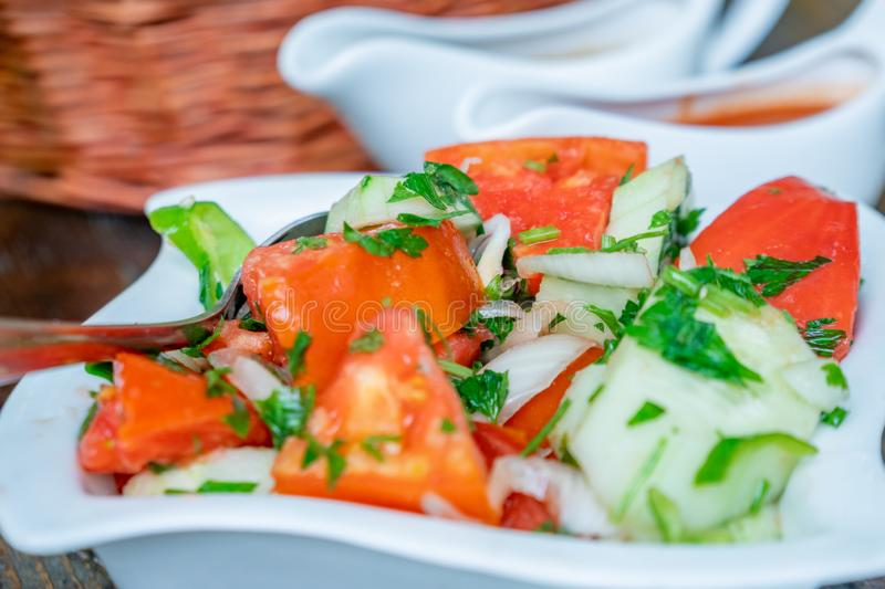 Tomato and cucumber salad with onion, pepper and parsly royalty free stock image