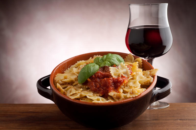 Tomato farfalle and wine royalty free stock images