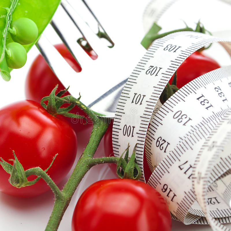 Free Tomato,fork ,peas And Measure Tape On A Plate Royalty Free Stock Photo - 19783035