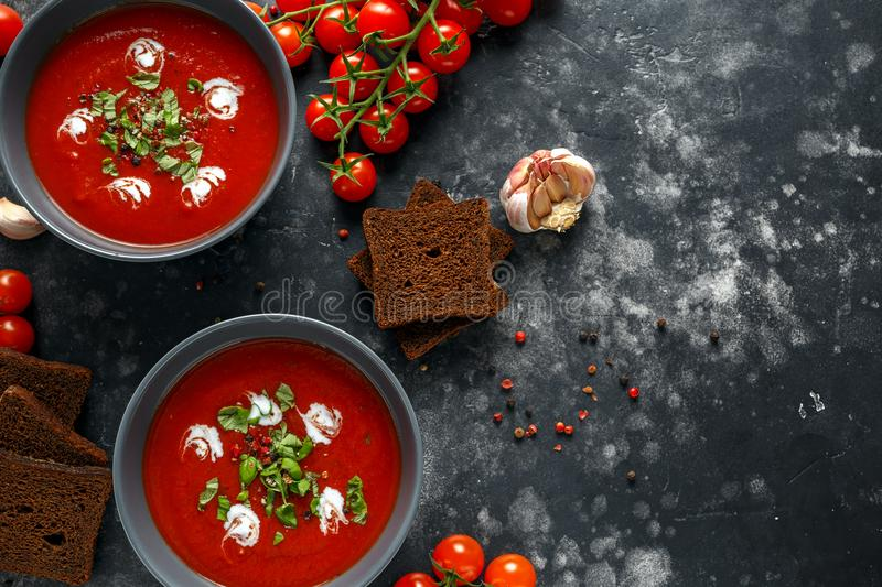Download Tomato And Fresh Basil Soup With Garlic, Cracked Papper Corns, Served With Cream And Sourdough Bread Stock Photo - Image of board, green: 113973122