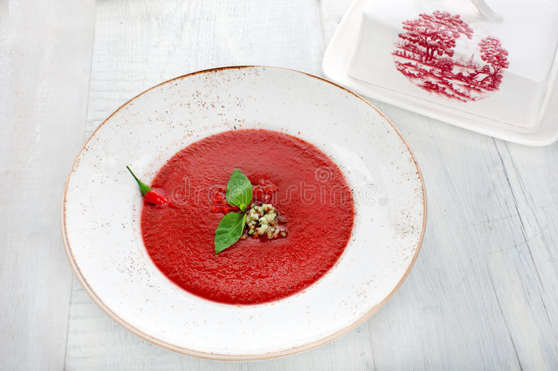 Tomato gazpacho soup with pepper and garlic royalty free stock photography