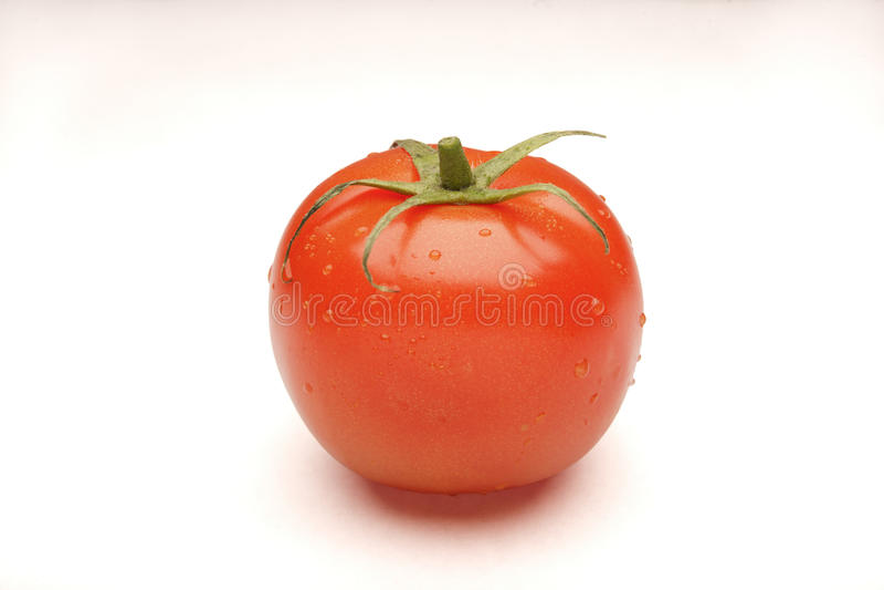 Tomato isolated on white stock images