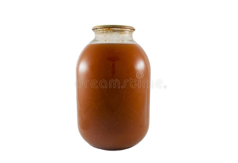 Tomato juice canned in the glass jar isolated royalty free stock photography