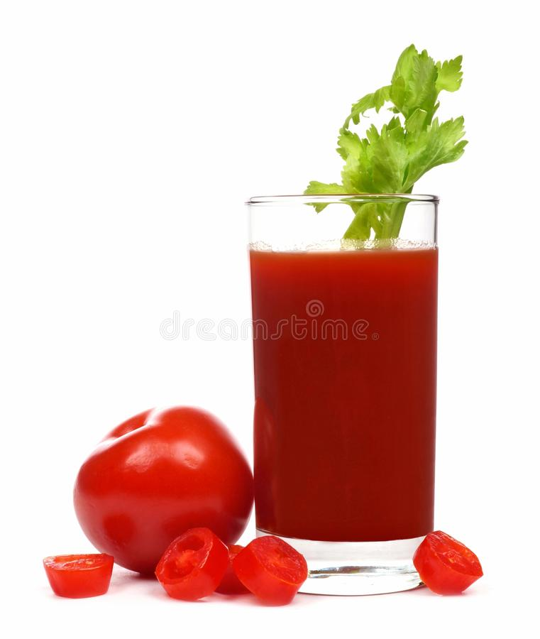 Tomato juice with celery and surrounding tomatoes isolated stock image
