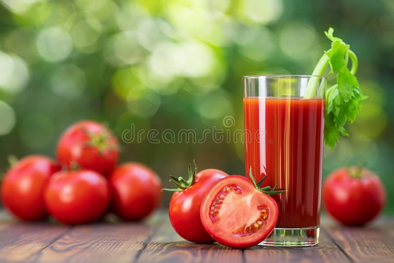 Tomato juice in glass stock photo
